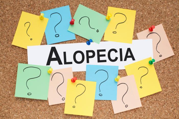 [Segno di alopecia con punti interrogativi]