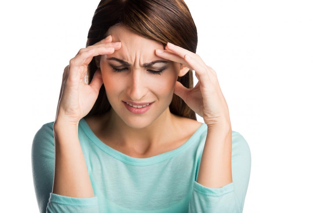 Pani z bólem głowy