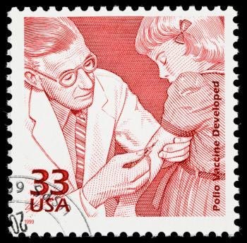 Jonas Salk, pionier szczepionki przeciw polio, na znaczku okolicznościowym z 1999 r. W USA.