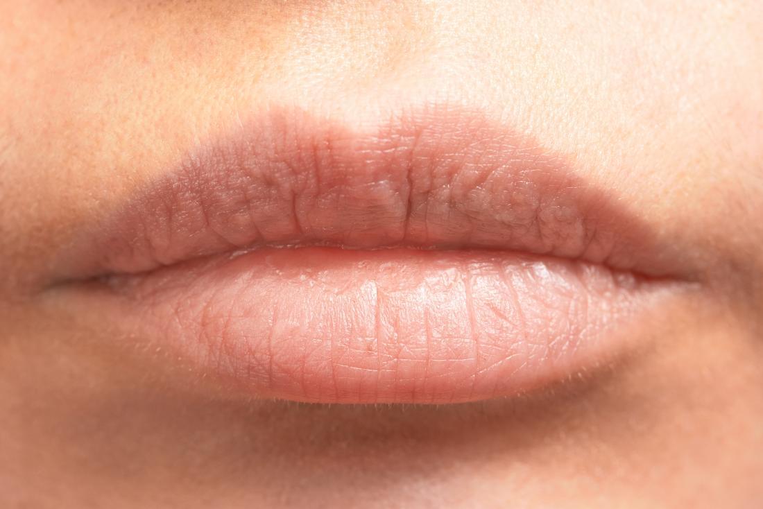gros plan des lèvres nues