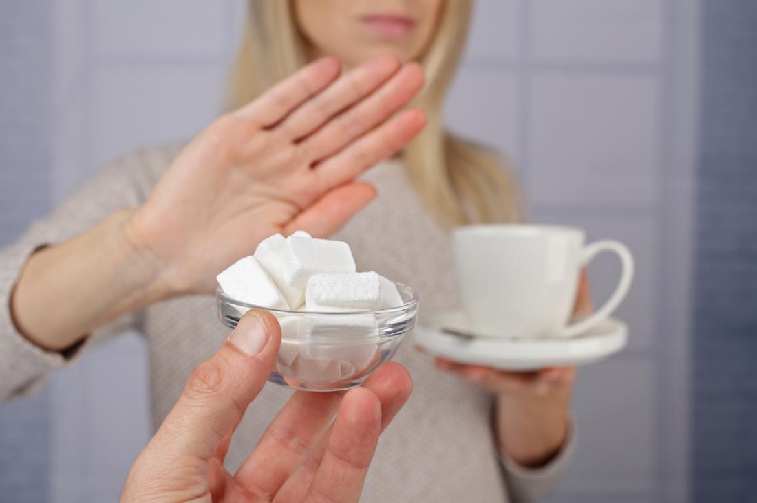 mulher dizendo não ao açúcar